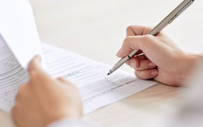 person signing an ndis service agreement